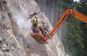 Crews burrowing into mountain to plant charges)